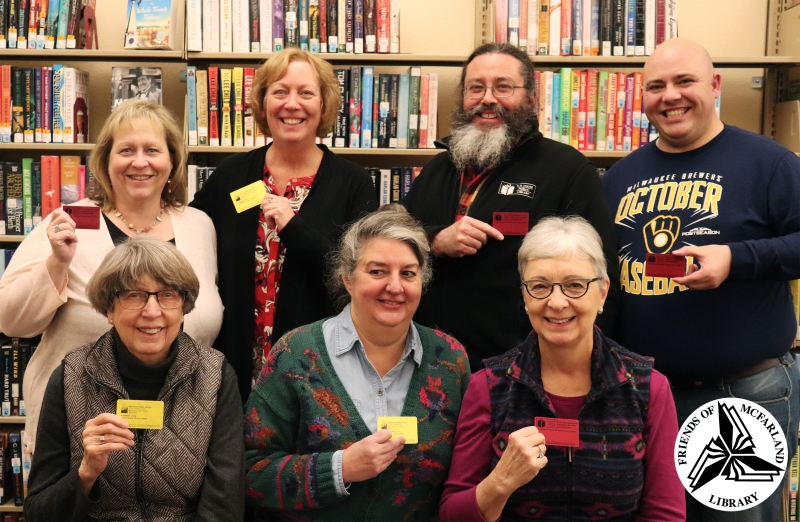 Friends of the McFarland Library members displaying their library cards