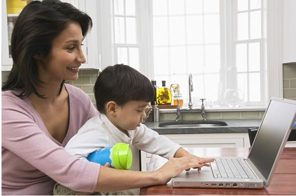mother and child using computer